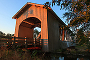 USA, Oregon, Scio, the Gilkey Bridge, covered bridge in early Autumn, at sunset.