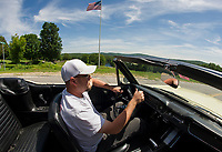 Denis Finnerty of Finn's Garage in Meredith cruises down Waukewan Street in a 1965 Ford Mustang convertible Friday afternoon.  (Karen Bobotas/for the Laconia Daily Sun)