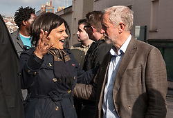 © Licensed to London News Pictures. 15/10/2015. Bristol, UK.  JEREMY CORBYN, leader of the Labour Party, visits shops in Picton Street, Montpelier, Bristol, with Labour's Bristol West MP Thangam Debbonaire (left), following a rally for Labour Party members at the Trinity Centre in Bristol, to highlight and oppose the impact of the Government's changes to voter registration, expected to remove 1 million voters from the electoral roll by the end of the year. Photo credit : Simon Chapman/LNP
