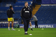 AFC Wimbledon coach Simon Bassey taking warm up during the EFL Trophy match between U21 Chelsea and AFC Wimbledon at Stamford Bridge, London, England on 4 December 2018.