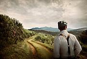 A man walks along a winding mountain path.