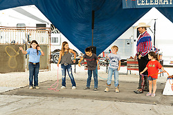 2021-08-06 McLean County 4H Fair.<br /> <br /> Children learning a rope trick at The Rhinestone Roper's Wild West Celebration