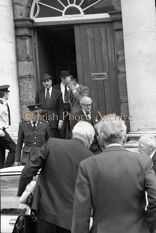 Bomb Damage, Green St. Court.15/07/1976.07/15/1976.15th July 1976..At the Special Criminal Court, Little Green Street, two bombs exploded causing extensive damage to the building. Four prisoners escaped, three of whom were subsequently re-captured. Pictured Justice Pringle, (back to camera), and Justice O'Hogan, (wearing hat), being escorted out of the Special Criminal Court after the explosion.