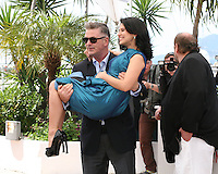 Alec Baldwin carries Hilaria Baldwin in his arms at the 'Seduced And Abandoned' film photocall at the Cannes Film Festival  Tuesday 21 May 2013