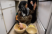Jamila Alrazouk prepares dinner for the family in her new apartment in Tampa, Florida, U.S. With the help of Coptic Orthodox Charities, the Alsaloums eventually settled into three apartments all within walking distance of each other.