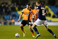 Brighton & Hove Albion's Danny Holla takes on Millwall's Jos Hooiveld<br /> <br /> Photographer Craig Mercer/CameraSport<br /> <br /> Football - The Football League Sky Bet Championship - Millwall v Brighton and Hove Albion - Tuesday 17th March 2015 - The Den - London<br /> <br /> © CameraSport - 43 Linden Ave. Countesthorpe. Leicester. England. LE8 5PG - Tel: +44 (0) 116 277 4147 - admin@camerasport.com - www.camerasport.com