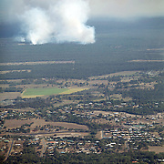 Aerial view of a bushfire near Bundaberg, Australia. A prolonged drought due to some of the hottest year's ever recorded in Australia has made the dangers of brushfires even greater.