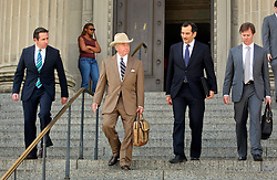 16 March 2015. New Orleans, Louisiana.<br /> Dick DeGuerin, (Brown suit with hat) Texas based lawyer for property billionaire Robert Durst leaves Orleans Parish Criminal District Court following a hearing to extradite his client to Los Angeles.<br /> Photo; Charlie Varley/varleypix.com