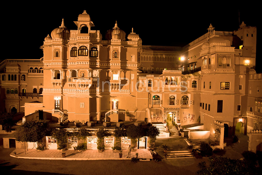 "Heritage hotel Deogarh Mahal at night, Udaipur, Rajasthan, India. This architectural jewel was, prior to it becoming a hotel in 1996, a fortress - palace, dating back 340 years it belonged to the Mewar aristocracy, their magnificent fort a fitting stronghold for one of its sixteen ""umraos"" - the most senior feudal barons attending on the Maharana of Udaipur."
