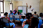 Female community health workers attend a class in the Bardia District Hospital in Bardia, Western Nepal, on 29th June 2012. In Bardia, StC works with the district health office to build the capacity of female community health workers who are on the frontline of health service provision like ante-natal and post-natal care, and working together against child marriage and teenage pregnancy especially in rural areas. Photo by Suzanne Lee for Save The Children UK