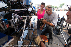 Doc Hopkins and Kersten Heling working on one of his drag bikes at the Sturgis Dragway during the Sturgis Black Hills Motorcycle Rally. Sturgis, SD, USA. Tuesday, August 6, 2019. Photography ©2019 Michael Lichter.