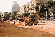 Israel Tel Aviv, Road works and infrastructure replacement in Dizengoff street near the Habimah theatre and Mann auditorium. Dizengoff tower in the background
