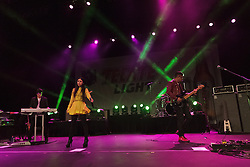 """LONG BEACH, CA - APR 13:  Mexican synthpop band Belanova perfomed a solid set including their new hit tic-toc at the 2012 Grand Prix of Long Beach. Belanovas founding members: Denisse Guerrero (lead vocals), Edgar Huerta (keyboards, programming), and Ricardo """"Richie"""" Arreola (bass, guitar). Although these are the only three official members, several other musicians perform in the band's live lineup, most notably Israel """"Campanita"""" Ulloa (drums) and Richo Acosta (guitar) All fees must be ageed prior to publication,.Byline and/or web usage link must  read SILVEX.PHOTOSHELTER.COM . Photo by Eduardo E. Silva"""
