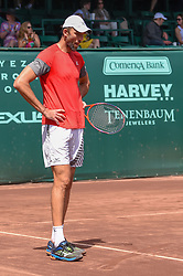 April 11, 2018 - Houston, TX, U.S. - HOUSTON, TX - APRIL 11: Ivo Karlovic (CRO) looks over a ball mark after the umpire ruled Denis Kudla's (USA) serve was in during the 2018 US Men's Clay Court Tennis Championships on April 11, 2018 at River Oaks Country Club, Houston, Texas. (Photo by Ken Murray/Icon Sportswire) (Credit Image: © Ken Murray/Icon SMI via ZUMA Press)