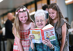 EDITORIAL USE ONLY<br /> Dame Jacqueline Wilson is joined by Sophie Raison, nine, and Elise Whitley, 10, as she helps to launch the easyJet Book Club, which is a new initiative to promote literacy and encourage kids to read, at Gatwick Airport in West Sussex.