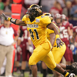 21 December 2008:  Southern Miss linebacker Tokumbo Abanikanda (41) celebrates after his team got the football on a fumble by Troy during the first half of the R+L Carriers New Orleans Bowl at the New Orleans Superdome in New Orleans, LA.