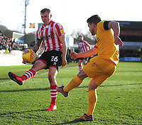 Northampton Town's David Buchanan clears under pressure from Lincoln City's Harry Anderson<br /> <br /> Photographer Andrew Vaughan/CameraSport<br /> <br /> The EFL Sky Bet League Two - Lincoln City v Northampton Town - Saturday 9th February 2019 - Sincil Bank - Lincoln<br /> <br /> World Copyright © 2019 CameraSport. All rights reserved. 43 Linden Ave. Countesthorpe. Leicester. England. LE8 5PG - Tel: +44 (0) 116 277 4147 - admin@camerasport.com - www.camerasport.com