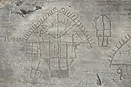 """Petroglyph, rock carving, detail of the so called """"Village"""" depicting  houses built on poles . Carved by the ancient Camunni people in the iron age between 1000-1600 BC. Rock no 24,  Foppi di Nadro, Riserva Naturale Incisioni Rupestri di Ceto, Cimbergo e Paspardo, Capo di Ponti, Valcamonica (Val Camonica), Lombardy plain, Italy .<br /> <br /> Visit our PREHISTORY PHOTO COLLECTIONS for more   photos  to download or buy as prints https://funkystock.photoshelter.com/gallery-collection/Prehistoric-Neolithic-Sites-Art-Artefacts-Pictures-Photos/C0000tfxw63zrUT4<br /> If you prefer to buy from our ALAMY PHOTO LIBRARY  Collection visit : https://www.alamy.com/portfolio/paul-williams-funkystock/valcamonica-rock-art.html"""