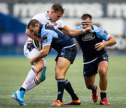 Duhan van der Merwe of Edinburgh Rugby under pressure from Garyn Smith of Cardiff Blues<br /> <br /> Photographer Simon King/Replay Images<br /> <br /> Guinness PRO14 Round 2 - Cardiff Blues v Edinburgh - Saturday 5th October 2019 -Cardiff Arms Park - Cardiff<br /> <br /> World Copyright © Replay Images . All rights reserved. info@replayimages.co.uk - http://replayimages.co.uk