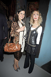 Left to right, President of the Polish City Club ROKSANA CIURYSEK and BASIA BRIGGS at a party to celebrate the opening of Topolski Century held at The Arches, Hungerford Bridge, London SE1 on 16th March 2009.