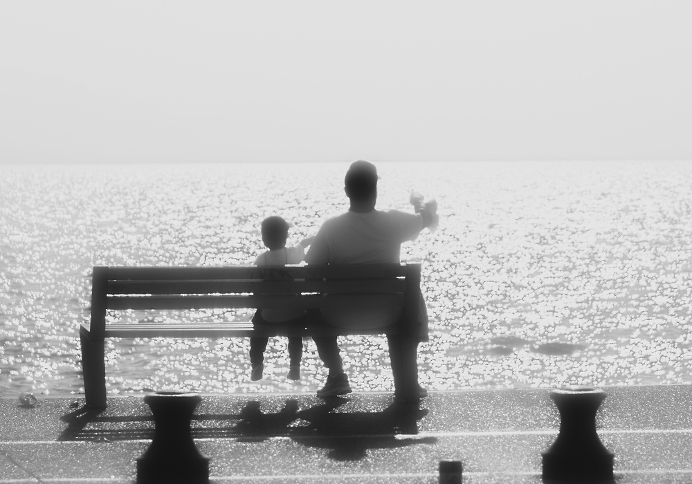 Father and son watching ships in Saloniki