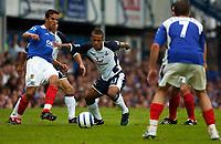Photo: Alan Crowhurst.<br /> Portsmouth v Tottenham Hotspur. Barclaycard Premiership.<br /> 13/08/2005. Wayne Routledge battles through the Pompey defence.