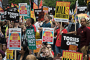 Peoples Assembly National Demonstration Against Theresa May and Austerity - Not One Day More - Tories Out arrives at Downing Street where protesters sit down in the road, onSaturday July 1st in London, United Kingdom. Tens of thousands of people gathered to protest in a march through the capital protesting against the Conservative Party cuts. Following the recent General Election where the Labour Party gained seats, while the Conservative Party lost their majority, the mood in the country has been one where an anti-austerity movement is growing as people become tired with Tory rule.