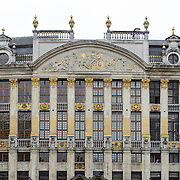 The facade of one of the guildhalls in the Grand Place, Brussels. Originally the city's central market place, the Grand-Place is now a UNESCO World Heritage site. Ornate buildings line the square, including guildhalls, the Brussels Town Hall, and the Breadhouse, and seven cobbelstone streets feed into it.