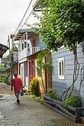 Man walking on the street in the town of El Castillo, Rio San Juan Department, Nicaragua