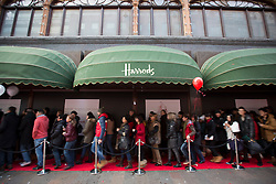© Licensed to London News Pictures. 26/12/2013. London, UK. A queue of shoppers advances as the doors open for the world famous Harrods department Boxing Day sale in London today (26/12/2013). Photo credit: Matt Cetti-Roberts/LNP