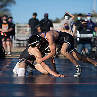 Gallup senior Joey Baca and Kirkland senior Miguel Prettyboy wrestle Wednesday evening at the Angelo DiPaolo Stadium in Gallup at Wrestle on the Gridiron hosted by Miyamura High School.