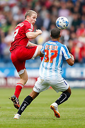 Grant Leadbitter of Middlesbrough and Lee Peltier of Huddersfield compete in the air - Photo mandatory by-line: Rogan Thomson/JMP - 07966 386802 - 13/09/2014 - SPORT - FOOTBALL - Huddersfield, England - The John Smith's Stadium - Huddersfield town v Middlesbrough - Sky Bet Championship.