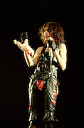 Alice Cooper holding parts of a baby doll