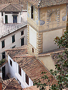 Tiled rooftops below the Hotel Alhambra Palace, Granada, Spain.