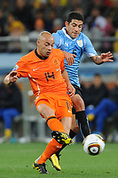 FOOTBALL - FIFA WORLD CUP 2010 - 1/2 FINAL - URUGUAY v NETHERLANDS - 6/07/2010 - DEMY DE ZEEUW (NED) - WALTER GARGANO (URU)<br /> PHOTO FRANCK FAUGERE / DPPI