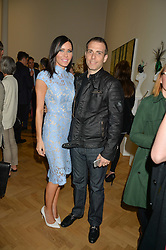 LINZI STOPPARD and WILL STOPPARD at a private view and auction of millinery organised by author, philanthropist and hat collector Eva Lanska in aid of Women for Women International held at Pace, Burlington Gardens, London on 10th June 2015.