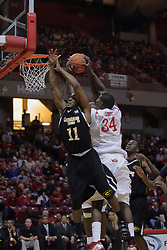 22 December 2009: Kevin Loyd gets knocked out of the way by Tony Lewis on a rebound attempt. The Tigers of Grambling State are defeated by the Redbirds of Illinois State 80-56 on Doug Collins Court inside Redbird Arena in Normal Illinois.