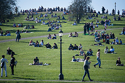 © Licensed to London News Pictures. 29/03/2021. London, UK. Members of the public relax in the warm weather on Primrose, Hill in North London, on the day that lockdown restrictions are eased. Photo credit: Ben Cawthra/LNP