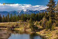 The Whitefish River in spring with Big Mountain in Whitefish, Montana, USA