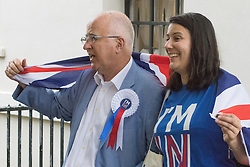 """Westminster, London, June 23rd 2016. Spotted outside Parliament is disgraced former Labour MP Denis MacShane who resigned in 2012 following his conviction for false accounting, posing with a woman in an """"I'M IN"""" t-shirt."""