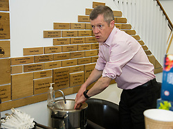 Pictured: Willie Rennie,<br /> <br /> Scottish Liberal Democrat leader Willie Rennie met staff and customers at the Grassmarket café, part of the Grassmarket Community Project, as he visited the Edinburgh social enterprise today as part of his election campaign. He took the opportunity to set out Lib Dem student support plans ahead of an NUS election hustings in Glasgow. <br /> Ger Harley | EEm 11 April 2016