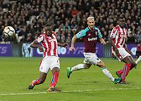 Football - 2017 / 2018 Premier League - West Ham United vs Stoke City<br /> <br /> Marko Arnautovic (West Ham United)  catches the ankle of Kurt Zouma (Stoke City) at the London Stadium<br /> <br /> COLORSPORT/DANIEL BEARHAM