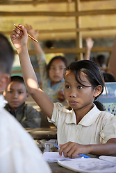 Soutchay (no age given) in her (no grade given) class which is a bamboo structure outside the school building. At the primary school in Phangthong Village, Pha Oudom District, Bokeo Province, Lao PDR