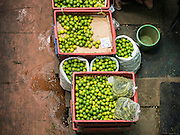 10 JANUARY 2014 - BANGKOK, THAILAND:   Limes for sale in Pak Khlong Talat, the flower market, in Bangkok.   PHOTO BY JACK KURTZ
