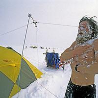 INTERNATIONAL ARCTIC PROJECT. Victor Boyarsky (MR) starts day of dog sledding on frozen Arctic Ocean with a snow bath, despite frigid temperatures.