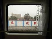 Suburbs of Longxi. Window view across China, from Hong Kong to Urumqi, Xinjiang.