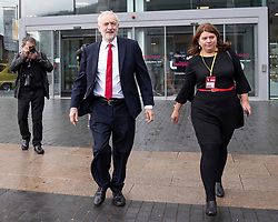 © Licensed to London News Pictures . 23/09/2018. Liverpool, UK. JEREMY CORBYN leaves the Museum of Liverpool with his aide Marsha-Jane Thompson, after recording an interview for the Marr Show . The first day of the 2018 Labour Party Conference at the Arena and Convention Centre in Liverpool . Photo credit: Joel Goodman/LNP