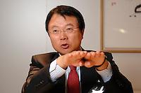 30 AUG 2007, BERLIN/GERMANY:<br /> JongWoo Park, President & CEO, Samsung Digital Media Business, waehrend einem Interview, Samsung Messestand, Internationale Funkausstellung, IFA<br /> IMAGE: 20070830-01-001<br /> KEYWORDS: Jong Woo Park