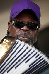 29 April 2012. New Orleans, Louisiana,  USA. <br /> New Orleans Jazz and Heritage Festival. <br /> C.J. Chenier, zydeco, creole and cajun playing accordian legend.<br /> Photo credit; Charlie Varley/varleypix.com