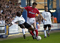 Foto: Digitalsport<br /> NORWAY ONLY<br /> Picture: Henry Browne.<br /> Date: 24/04/2004.<br /> Fulham v Charlton Athletic FA Barclaycard Premiership.<br /> <br /> <br /> Luis Boa Morte of Fulham is pushed off the ball by Hermann Hreidarsson of Charlton.